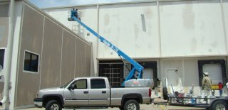 commercial painters working on building